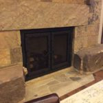 wrought iron fireplace screen with latch